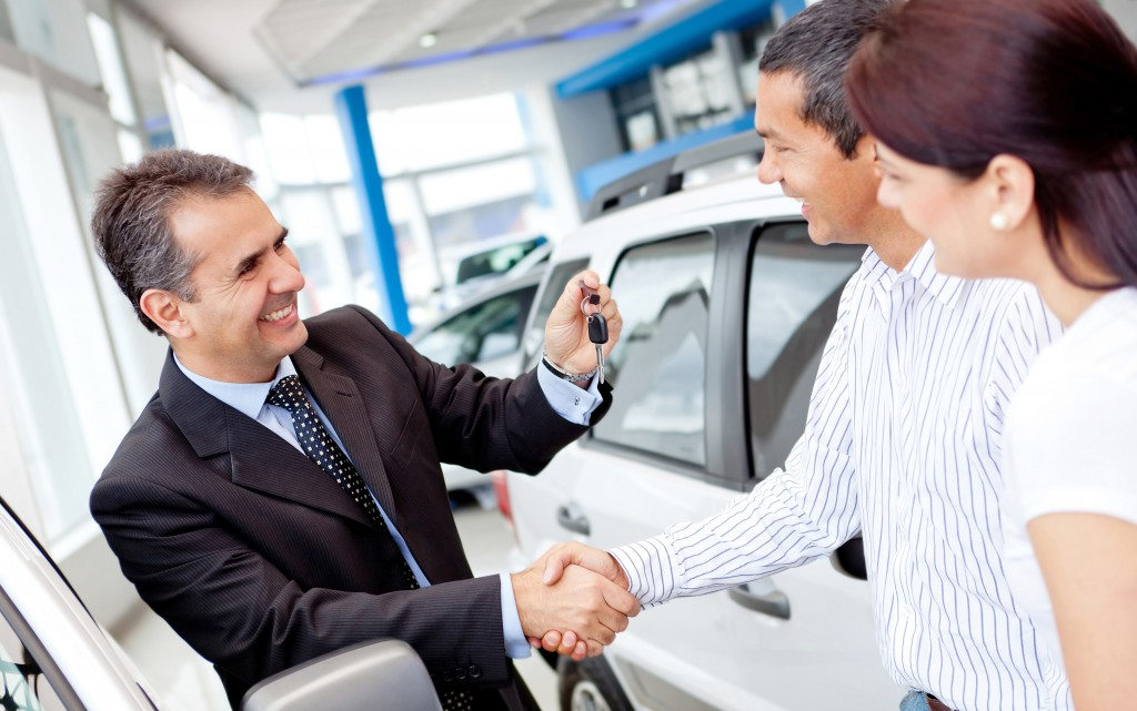 Happy-Car-Salesman-closing-deal